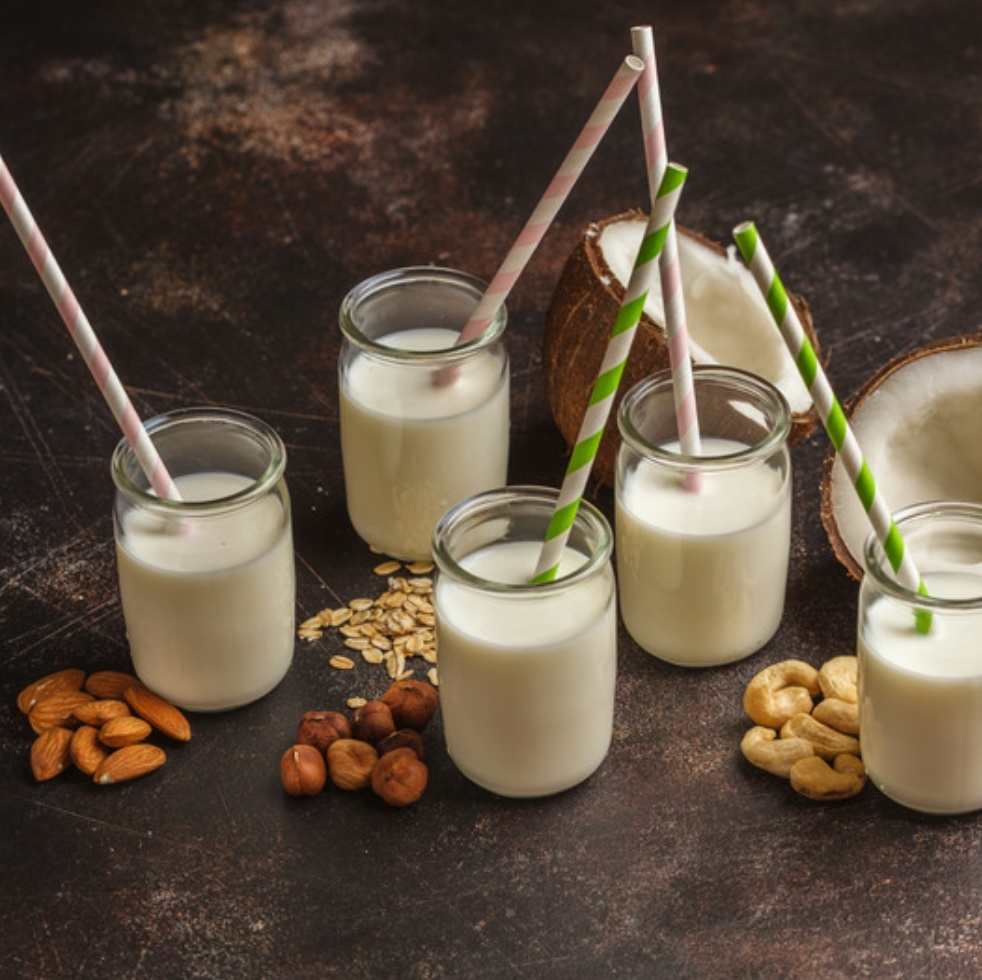 Nut milk glasses with nuts